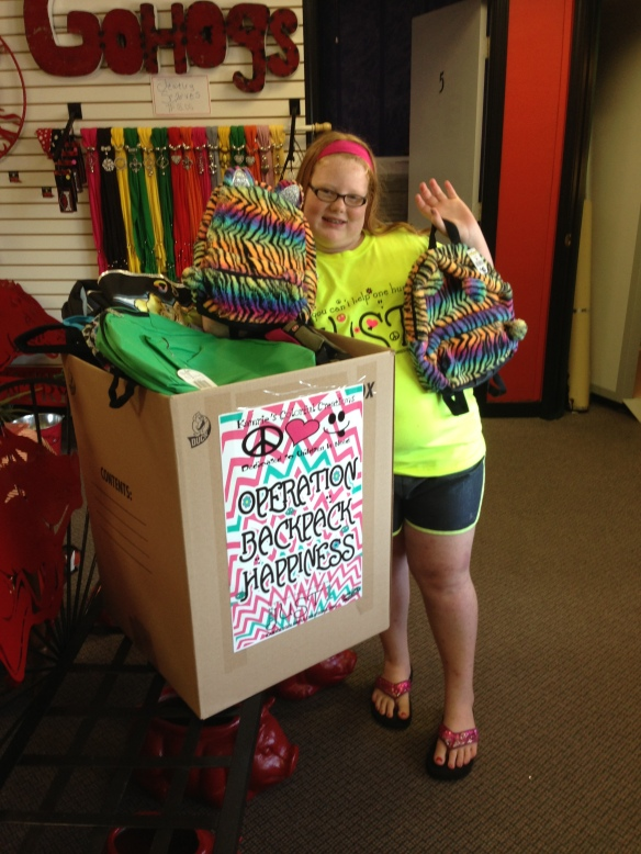 Kamrie picking up tons of backpacks from Razorback Tanning