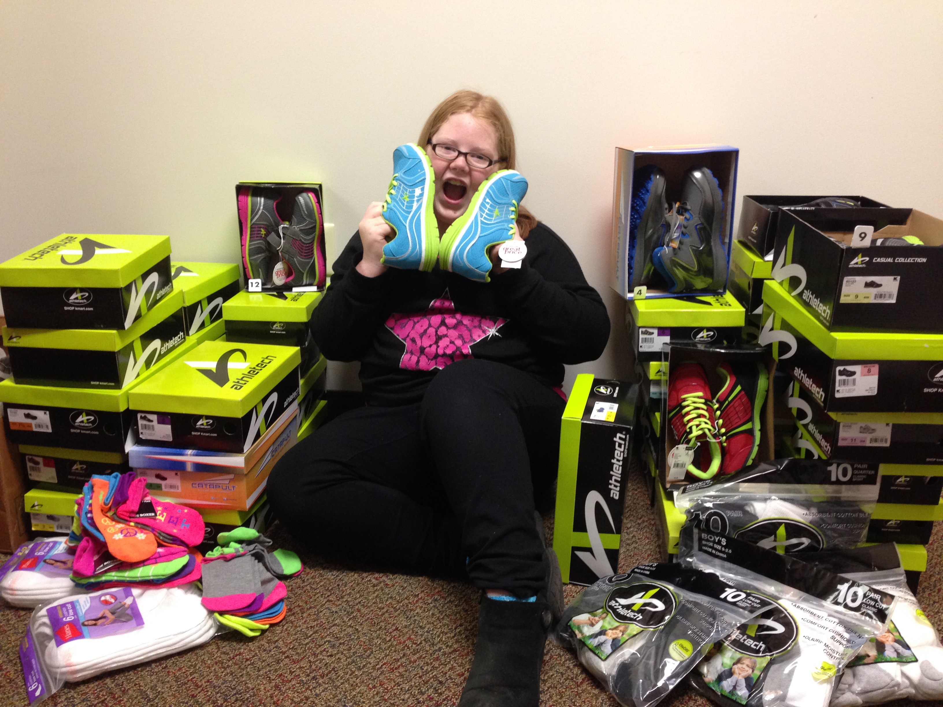 Kamrie donating 37 pairs of shoes and socks to Dover Elementary School