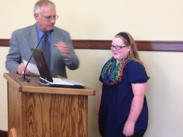 Kamrie and Mayor Eaton as he reads the proclamation before the city council