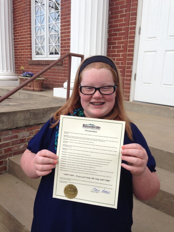 "Kamrie outside City Hall just after Mayor Eaton finished proclaiming May 16, 2014 as ""JUST1 Day"" for the City of Russellville"